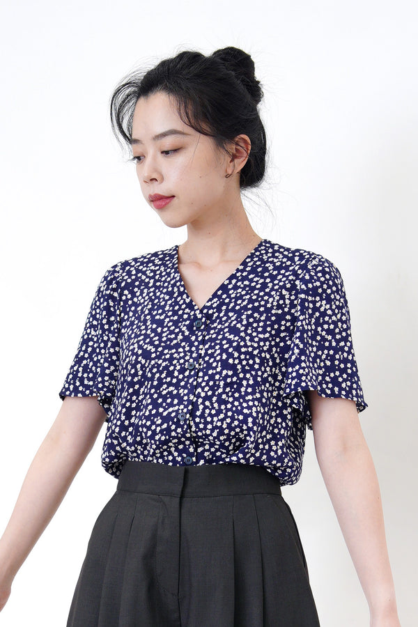 Navy floral blouse in frill sleeves