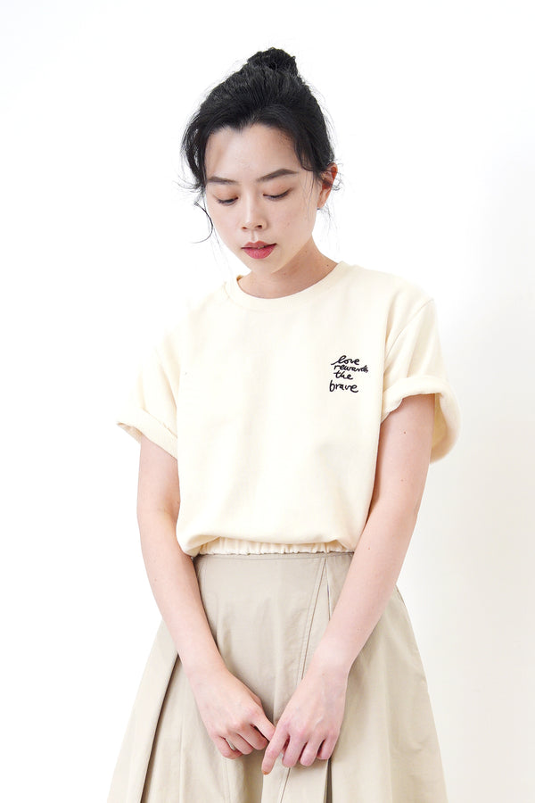 Cream embroidery top in elastic hem