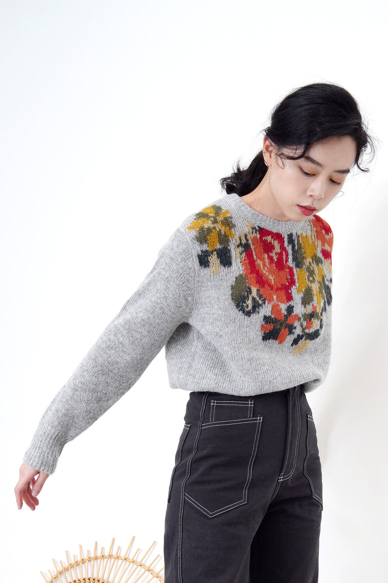 Grey knit sweater in floral cross stitch