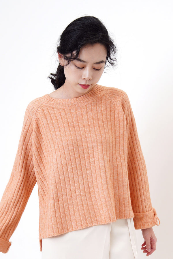 Peach knit sweater in stepped hem