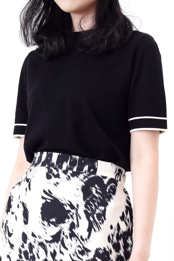 Black soft knit top in contrast outline