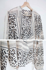 Wrap style blouse in animal print