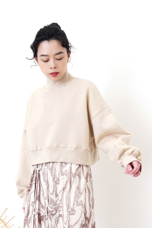 Nude crop cut pullover in stand collar