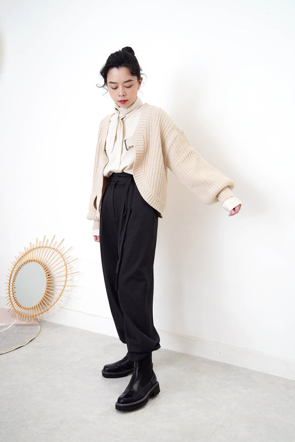 Beige knit cardigan in strap buckle