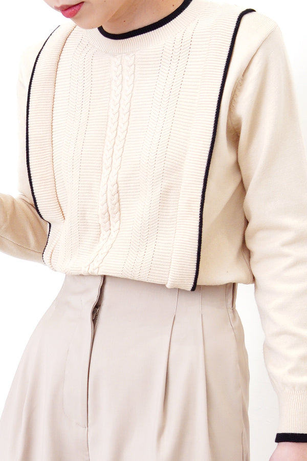 Beige pattern front sweater w/ outlined details