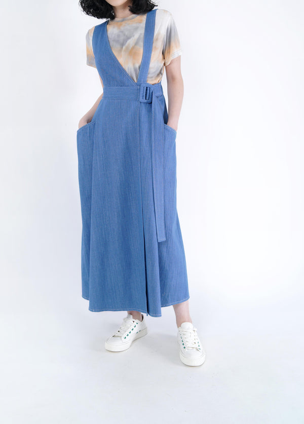 Blue denim wrap front one piece in assy. cut