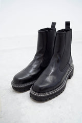 Black outlined chunky chelsea boots