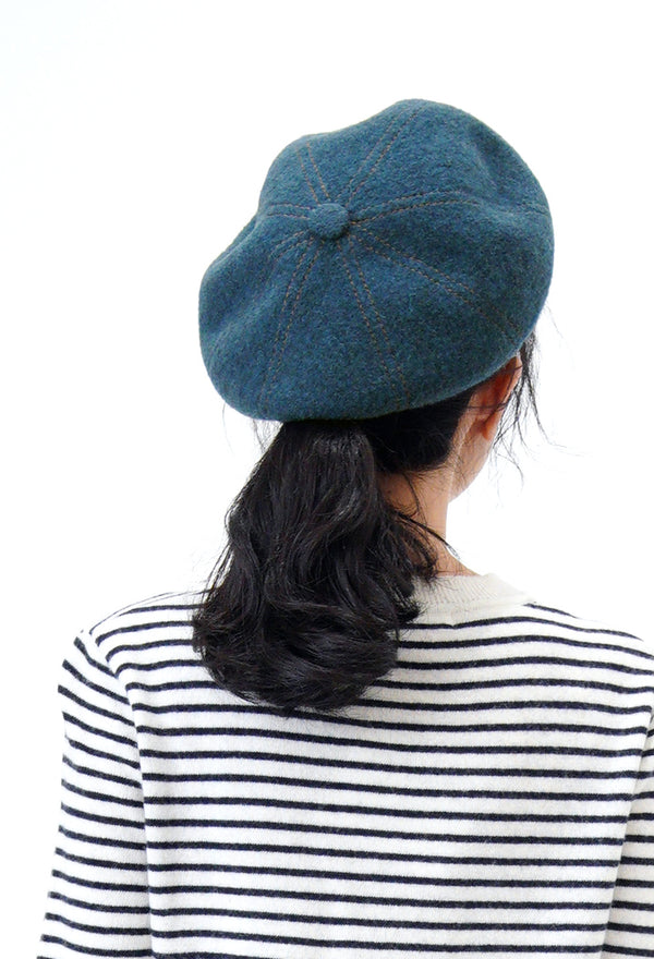 Blue beret in outline stitching