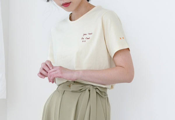 Cream tee top in embroidery letters
