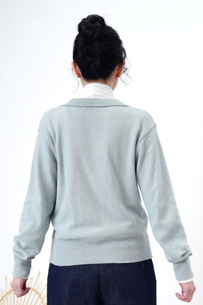 Light blue knit top in overlap v neck cut