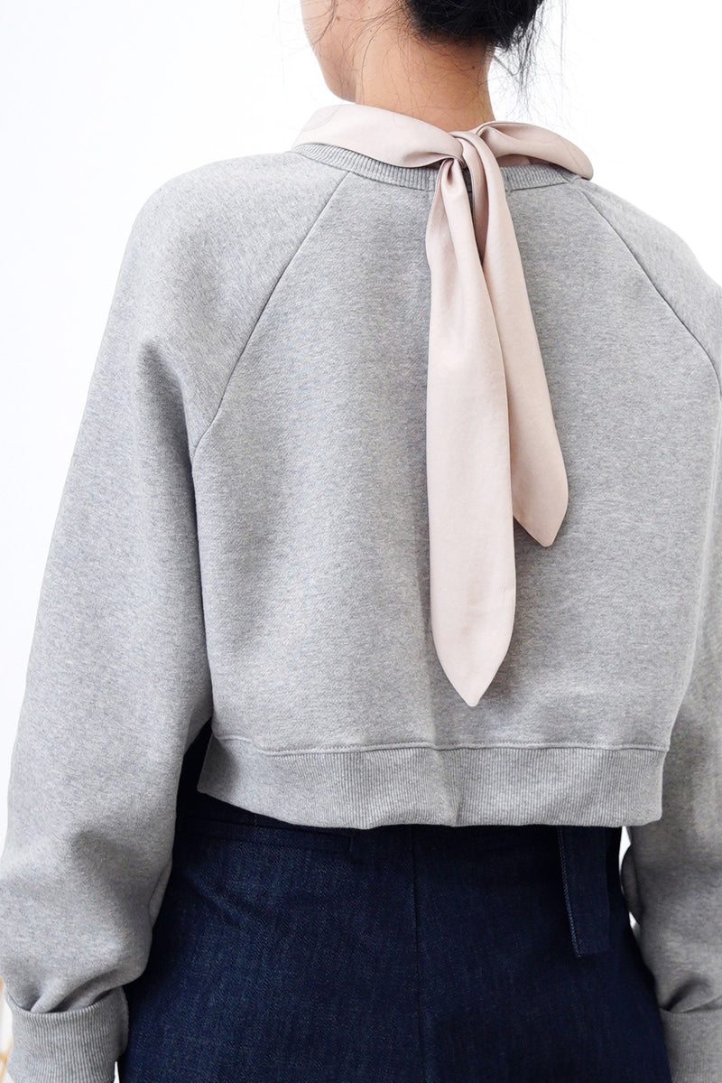 Dusty pink blouse in detail tie neck stand collar