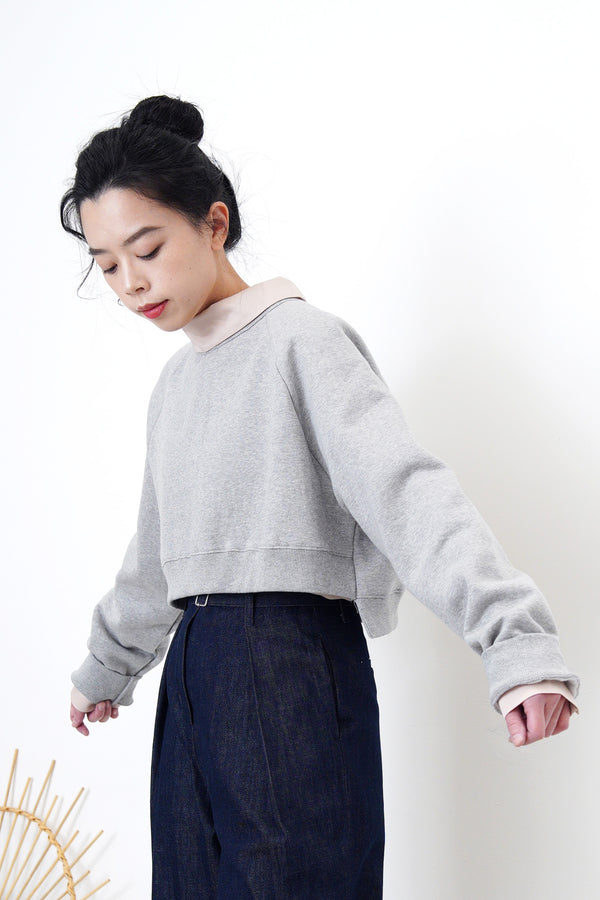 Grey crop cut pullover in stepped hem