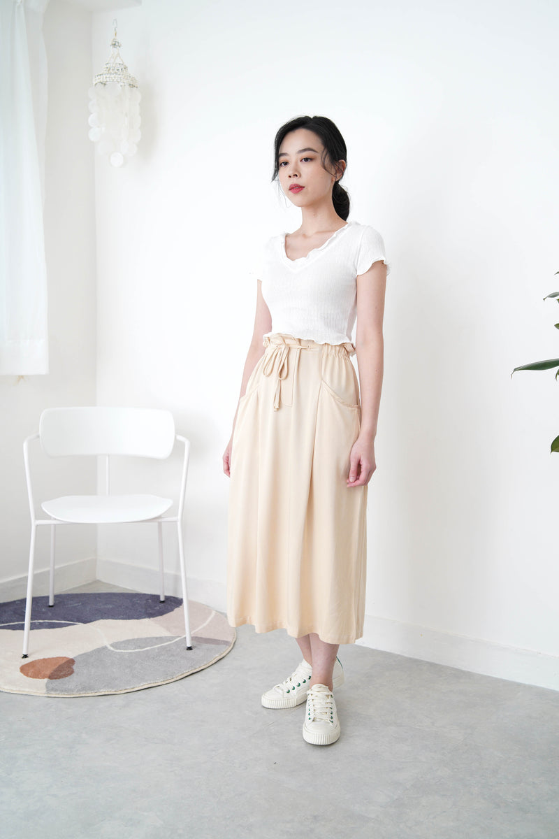 Cream h cut skirt in ruffle waist string