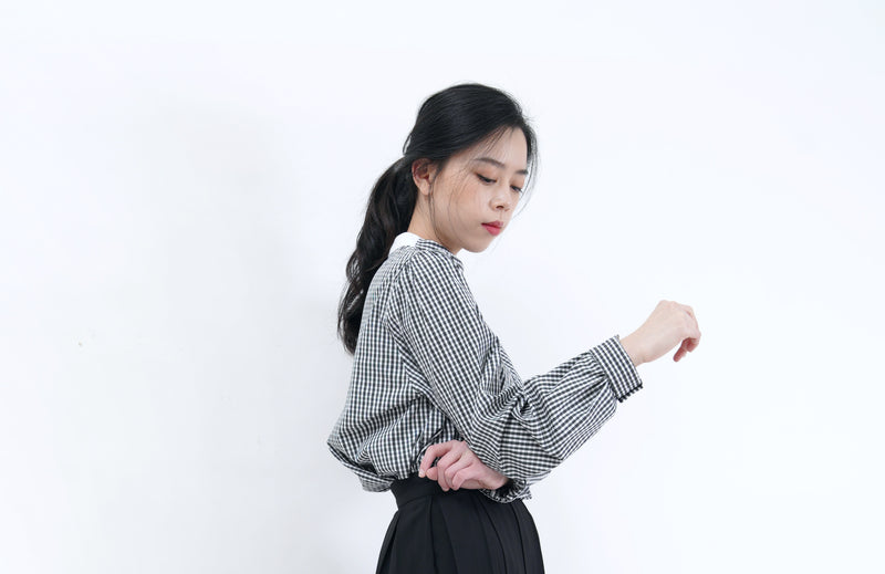 Check blouse in detail stand collar