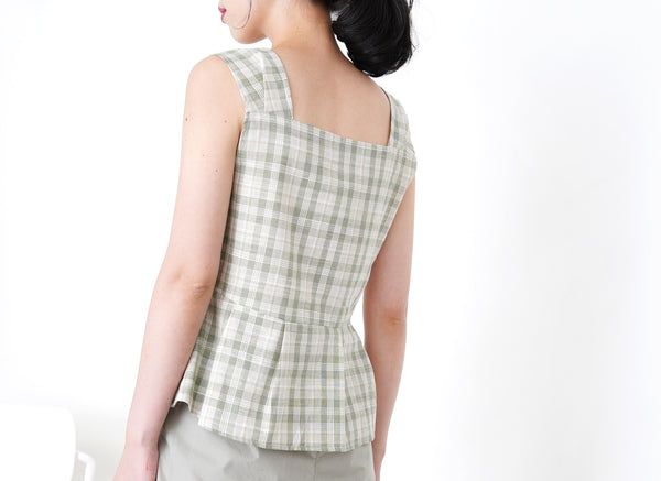 Green checked vest in peplum hem