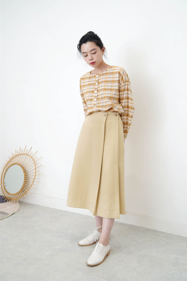 Yellow checked blouse in round hem