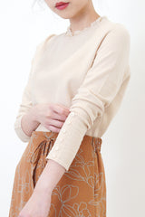 Nude soft knit sweater with ruffle collar