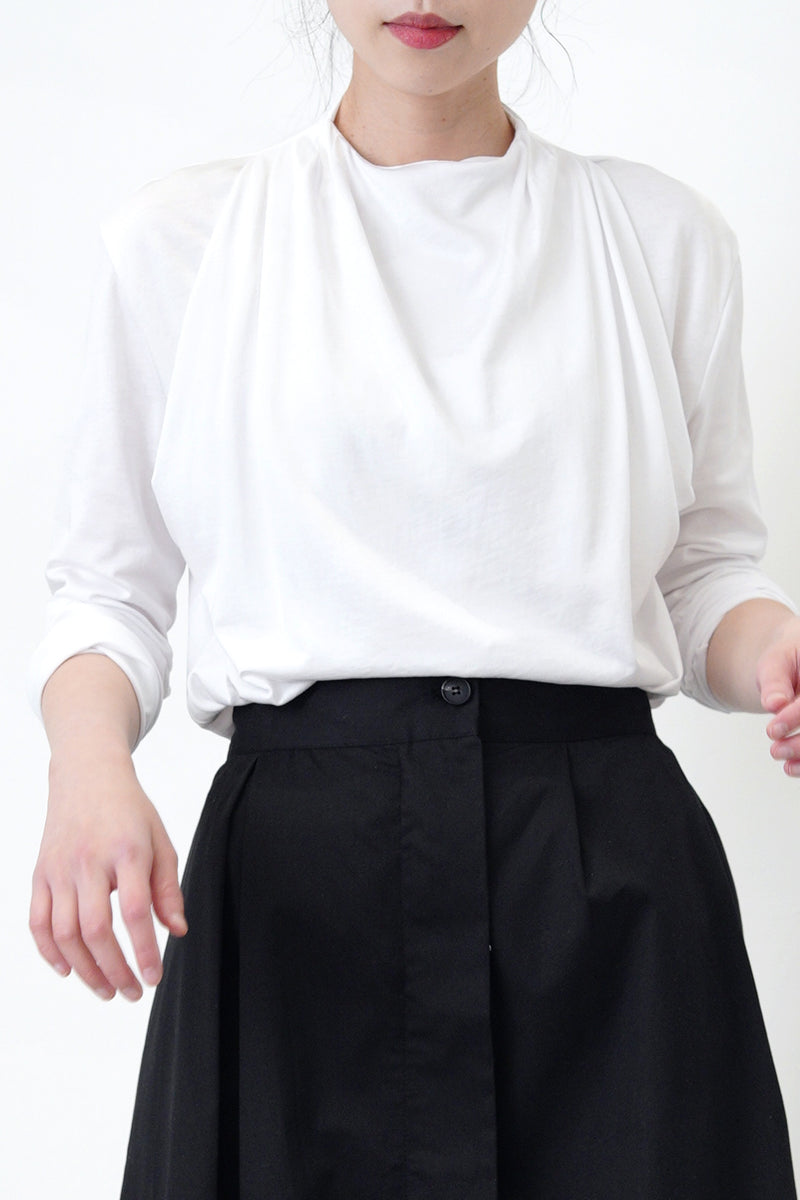 White blouse in drape layering detail