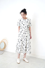White dress in brush stroke pattern