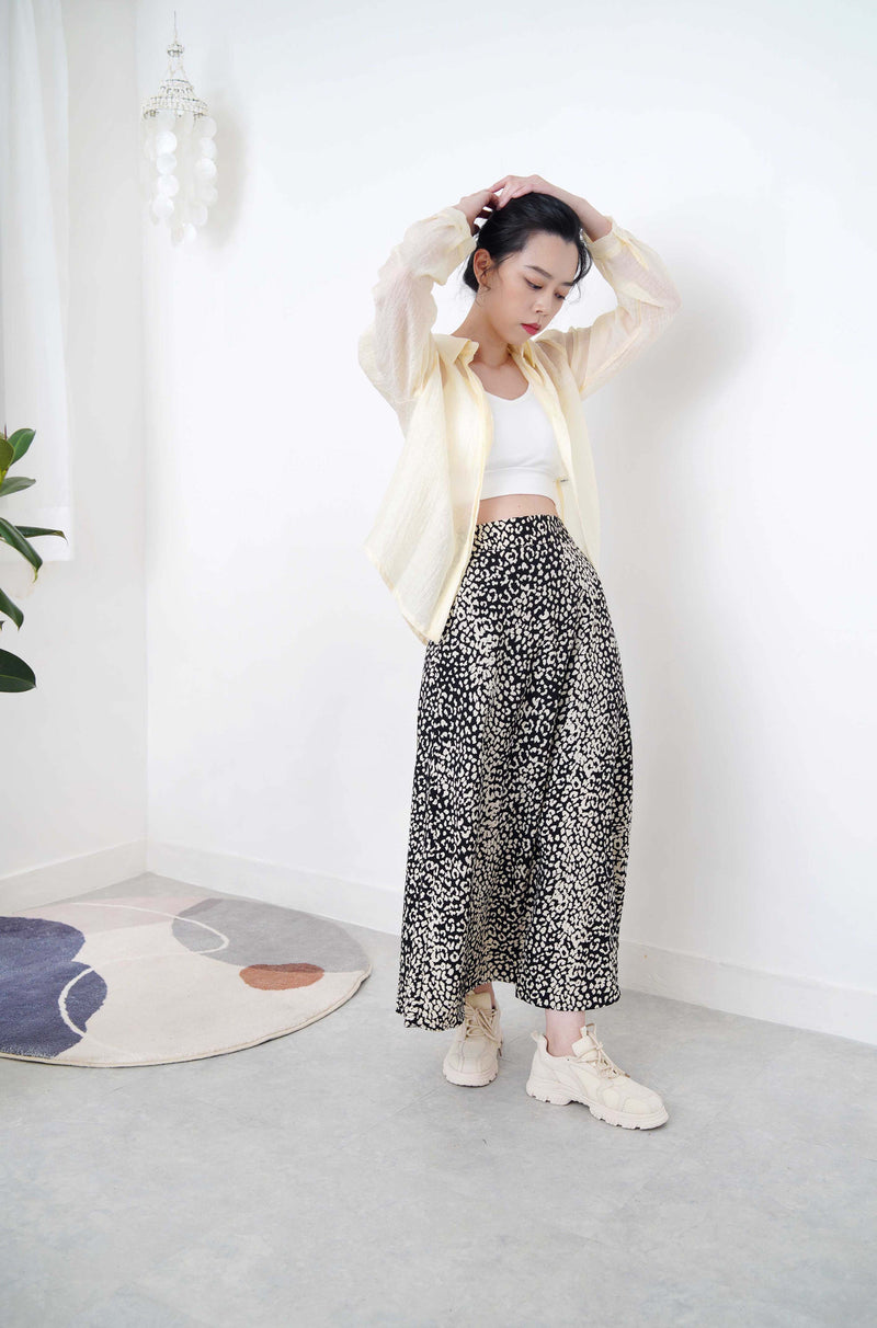 Black flare cut skirt in animal print