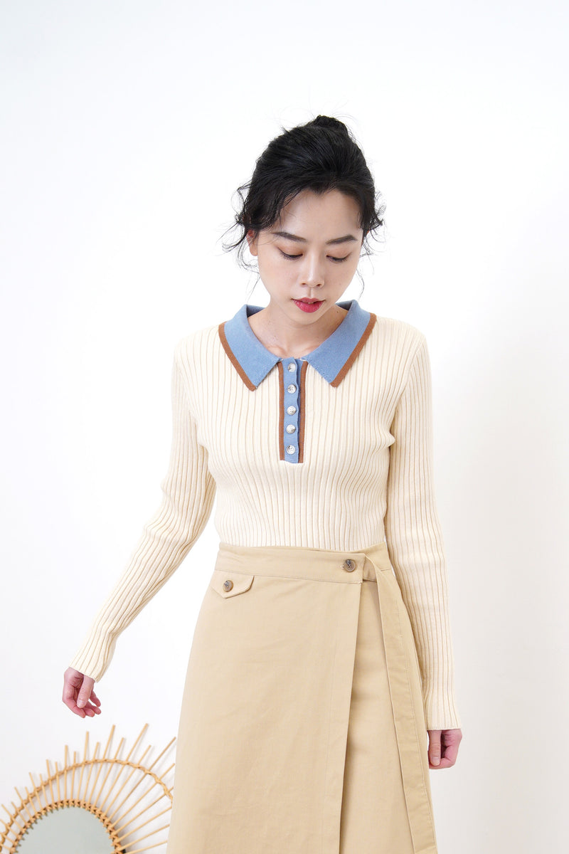 Light beige knit top w/ blue polo collar