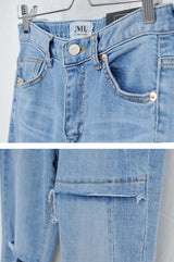 Blue high waist jeans in ripped details