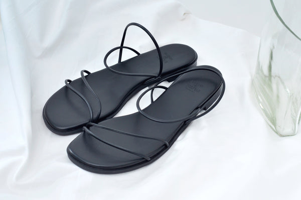Black flat sandals in thin straps