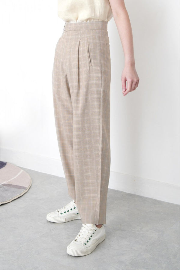 Beige checked trousers in waist detail