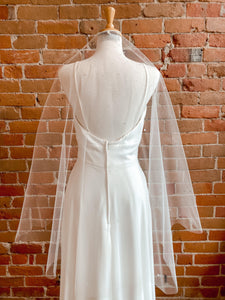 Raw Edge w/ Crystals Throughout Single Tier Ivory Veil - V8028