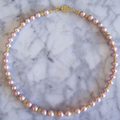 Serenata Necklace, cultured freshwater pearls and 22kt gold