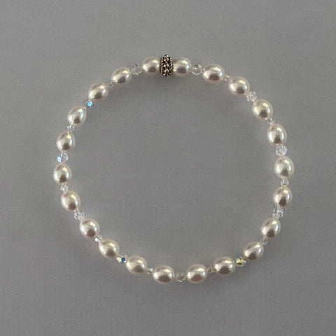 "7-1/3"" stretch bracelet with soft white color uniform oval shaped cultured freshwater pearls & Swarovski crystal beads / Arpaia Jewelry"