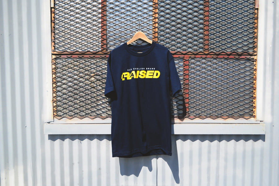 OE- LA RAISED (NAVY)