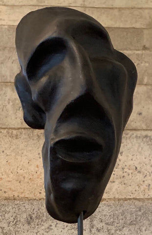 clay sculpture , head sculpture on plinth , ceramic face mask