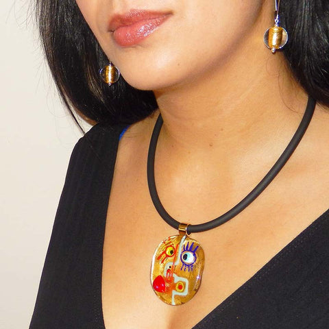 Model wearing CUBIST FACE 2 modern 24kt gold leaf murano glass necklace and SPARKLE earrings, handmade in Italy