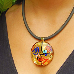 Model wearing CUBIST FACE 3 modern murano glass necklace, 24kt gold leaf pendant on black tubino, handmade in Italy