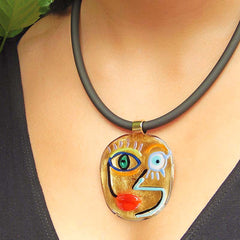 Model wearing CUBIST FACE 4 modern murano glass necklace, 24kt gold leaf pendant on black tubino, handmade in Italy