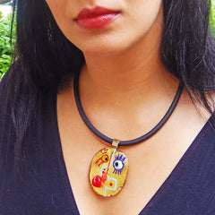 Model wearing CUBIST FACE 2 modern murano glass necklace, 24kt gold leaf pendant on black tubino, handmade in Italy