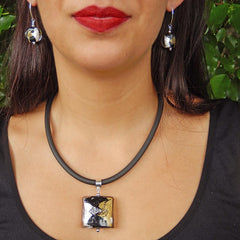 Model wearing GLITTER SQUARE BLACK modern murano glass necklace and GLITTER BLACK earrings, handmade in Italy