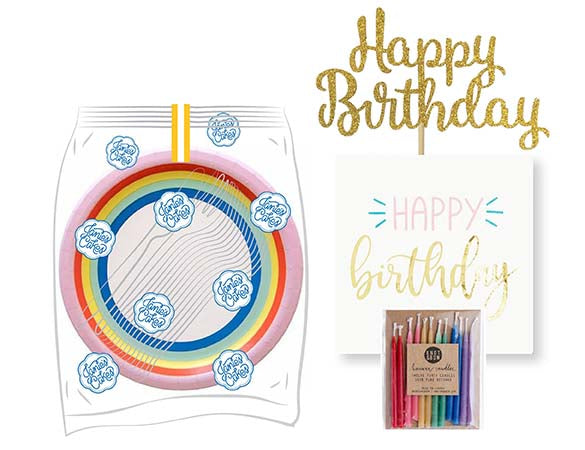 A large birthday party pack includes: 15 Rainbow Party Plates. 15 Happy Birthday Napkins. 15 Clear Plastic Forks. 1 Clear Plastic Knife. 1 - 12 Count Rainbow Beeswax Candles. 1 Gold Happy Birthday Cake Topper. Packaged in a Janie's Cakes logo printed cellophane bag.