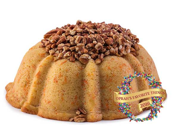 Carrot and cinnamon pound cake in the shape of a bundt filled with cinnamon cream cheese buttercream and topped with toasted pecans. serves 12. Oprah's Favorite Things. Packaged in our signature yellow and white striped gift box with a blue bow.