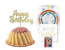 Load image into Gallery viewer, Vanilla pound cake in the shape of a bundt filled with vanilla buttercream and topped with all natural sprinkles. Serves 6. Packaged in our signature yellow and white striped gift box with a blue bow. With a A small birthday party pack that includes: 6 Rainbow Party Plates. 6 Happy Birthday Napkins. 6 Clear Plastic Forks. 1 Clear Plastic Knife. 1 - 12 Count Rainbow Beeswax Candles. 1 Gold Happy Birthday Cake Topper. Packaged in a Janie's Cakes logo printed cellophane bag.