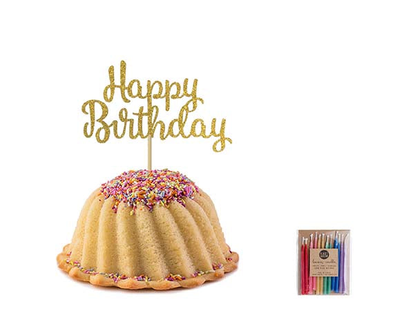 Vanilla pound cake in the shape of a bundt filled with vanilla buttercream and topped with all natural sprinkles. Serves 6. Packaged in our signature yellow and white striped gift box with a blue bow. Also includes a gold happy birthday cake topper and a 12 count of rainbow candles.