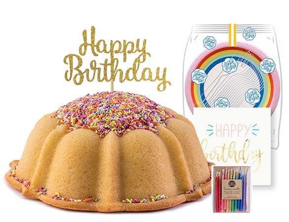 Vanilla pound cake in the shape of a bundt filled with vanilla buttercream and topped with all natural sprinkles. Serves 12. Packaged in our signature yellow and white striped gift box with a blue bow. With a A small birthday party pack that includes: 15 Rainbow Party Plates. 15 Happy Birthday Napkins. 15 Clear Plastic Forks. 1 Clear Plastic Knife. 1 - 12 Count Rainbow Beeswax Candles. 1 Gold Happy Birthday Cake Topper. Packaged in a Janie's Cakes logo printed cellophane bag.