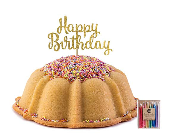 Vanilla pound cake in the shape of a bundt filled with vanilla buttercream and topped with all natural sprinkles. Serves 12. Packaged in our signature yellow and white striped gift box with a blue bow. Also includes a gold happy birthday cake topper and a 12 count of rainbow candles.