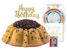 Load image into Gallery viewer, Chocolate chip pound in the shape of a bundt filled with vanilla buttercream and topped with chocolate chips. Serves 12 Packaged in our signature yellow and white striped gift box with a blue bow. A large birthday party pack that includes: 15 Rainbow Party Plates. 15 Happy Birthday Napkins. 15 Clear Plastic Forks. 1 Clear Plastic Knife. 1 - 12 Count Rainbow Beeswax Candles. 1 Gold Happy Birthday Cake Topper. Packaged in a Janie's Cakes logo printed cellophane bag.