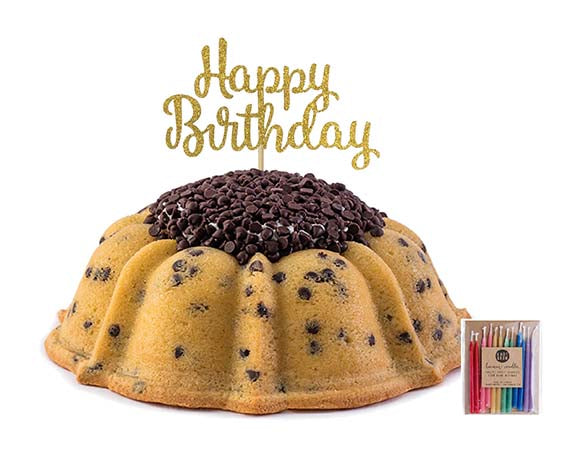Chocolate chip pound in the shape of a bundt filled with vanilla buttercream and topped with chocolate chips. Serves 12. Packaged in our signature yellow and white striped gift box with a blue bow. Also includes a gold happy birthday cake topper and a 12 count of rainbow candles.