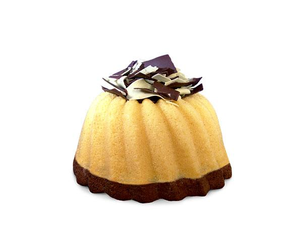 A slice of marbled vanilla and chocolate pound cake in the shape of a bundt filled with chocolate sauce and topped with dark and white chocolate shavings. Serves 6. Packaged in our signature yellow and white striped gift box with a blue bow.