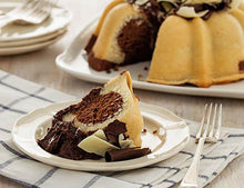 Load image into Gallery viewer, A slice of marbled vanilla and chocolate pound cake in the shape of a bundt filled with chocolate sauce and topped with dark and white chocolate shavings. Serves 12. Oprah's Favorite Things. Packaged in our signature yellow and white striped gift box with a blue bow.
