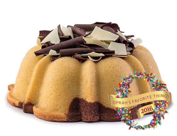 Marbled vanilla and chocolate pound cake in the shape of a bundt filled with chocolate sauce and topped with dark and white chocolate shavings. Serves 12. Oprah's Favorite Things. Packaged in our signature yellow and white striped gift box with a blue bow.