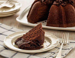 A slice of chocolate pound cake in the shape of a bundt filled with chocolate sauce and topped with chocolate shavings. Serves 12. Oprah's Favorite Things. Packaged in our signature yellow and white striped gift box with a blue bow.